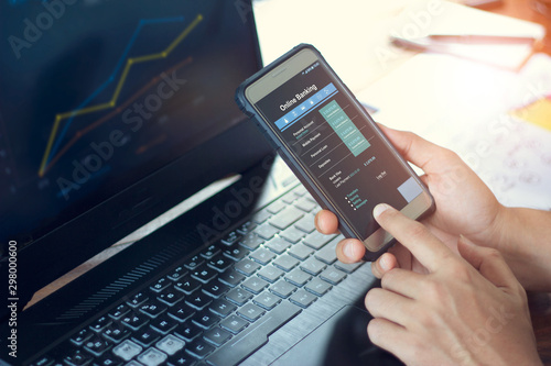 Fototapeta Businessman using mobile smartphone with data information banking network connection on screen, mobile banking and online payment. obraz