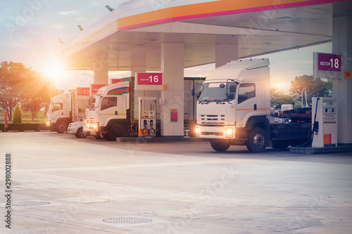 Recess Fitting Amsterdam Trucks refueling in petrol station, Transportation vehicle, Business logistics, delivery transport, cargo logistic concept. Freight shipping, at sunset background.