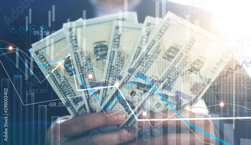 Photo  Business investment and stock market, Businessman holding dollars banknotes in hands, Economic growth, Currency exchange, Business financial concept