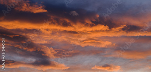 Poster Amsterdam Dramatic sky with orange clouds. Nature background.