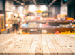 canvas print picture Wood texture table top (counter bar) with blur grocery,market store background