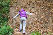 A Girl Runs Away Through The Forest. The Child Runs Uphill. The Girl Quickly Runs Forward.