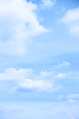 Pastel blue sky with light clouds