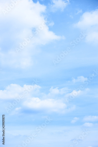 Pastel blue sky with light clouds - 298011875
