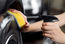 Car Wash Service, Detailing Using Spray And Sponge To Wipe Black Tire