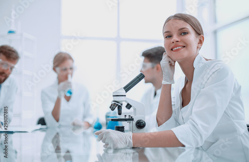 Stampa su Tela close up. woman scientist sitting at the lab table