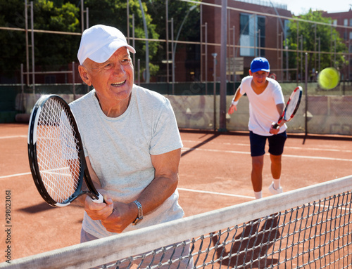 Fototapeta  tennis players of different generations playing tennis court