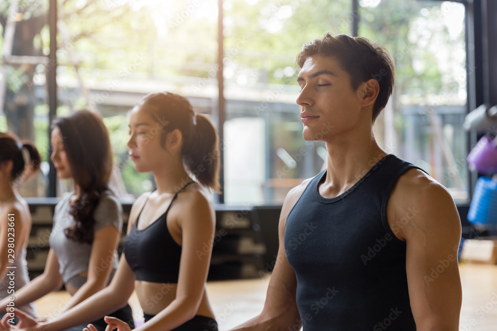 Fototapety, obrazy: Close up group of adult people practicing yoga in the class.