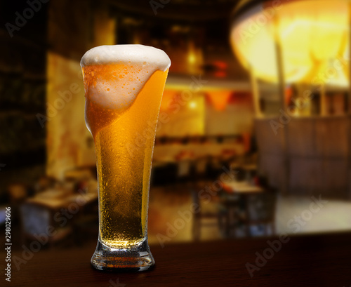 Canvas Prints Beer / Cider cold glass with beer on the background of bar.