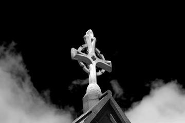 A sun lit church stone Cruc...