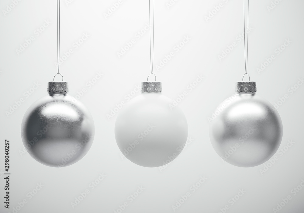 Fototapety, obrazy: Glossy metallic christmas baubles hanging in front of white background.