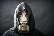 Man In A Gas Mask And Hooded C...