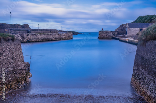 Платно Long exposure of Ballintoy harbour, Game of Thrones filming location for iron is