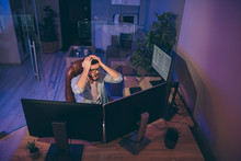 Oh No. Hign Angle View Photo Of It Specialist Loser Guy Sitting Chair Many Monitors Noticed Server Debugging Holding Hands On Head Need To Edit Errors Night Office Indoors