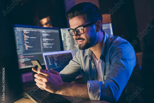 Aluminium Prints Akt Close-up portrait of his he nice attractive skilled cheerful cheery guy consultant texting sending sms web internet online app 5p fast speed service in dark room workplace station indoors