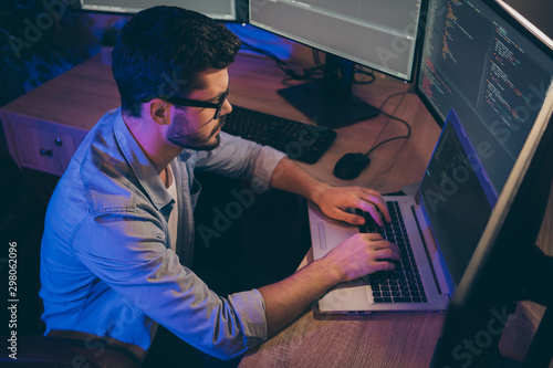 Profile photo of it specialist guy working late at night sitting comfy office ch Tablou Canvas