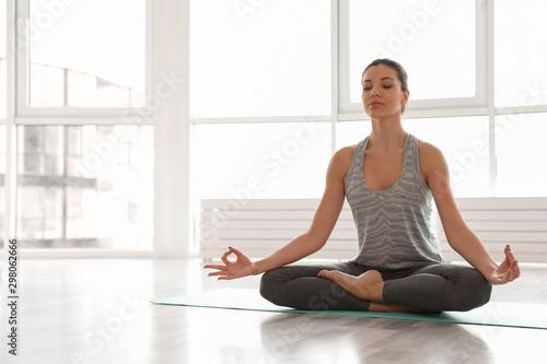 Young woman practicing yoga in studio Tapéta, Fotótapéta