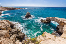 The Bridge Of Lovers Or Monk Seal Arch, Stone Cliffs In The Mediterranean Sea In Ayia Napa, Cyprus.