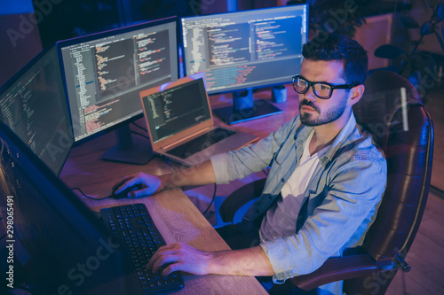 Portrait of his he nice attractive focused brunette guy creating script coding j Wallpaper Mural