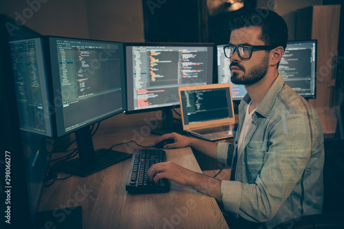 Obraz Photo of serious administrator responsible for cyber security of large corporation searching for safety gaps debugging existant operating system to reduce hacker attacks success probability - fototapety do salonu