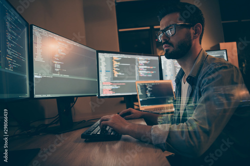 Photo of serious programmer puzzled about arisen error in security system of clo Fototapete