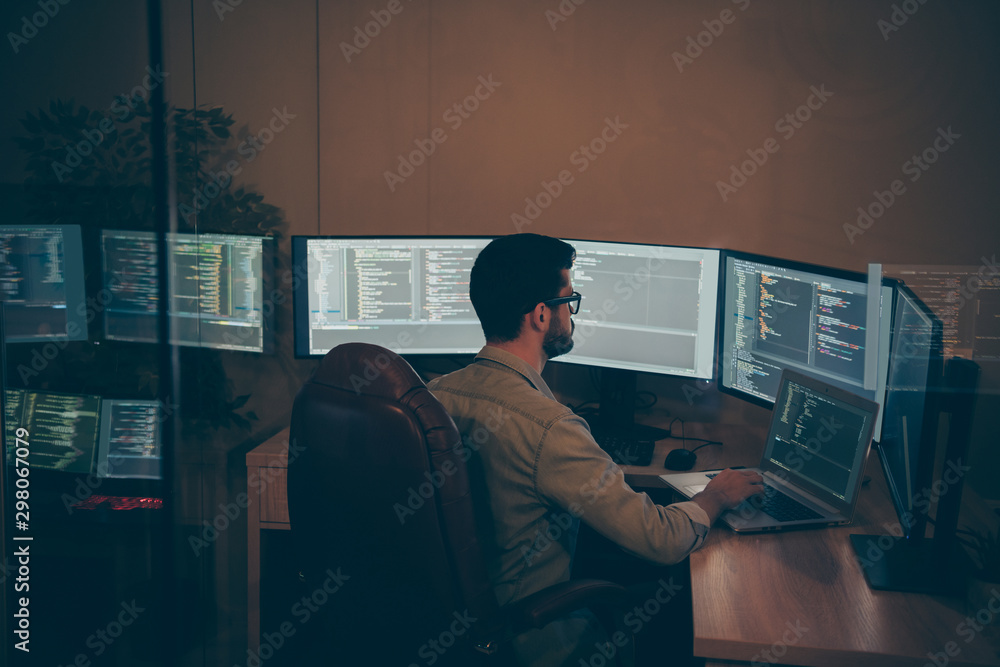 Fototapety, obrazy: Photo of it-specialist working on global project using laptop testing alpha version of newly developed software checking bug existence debugging script code