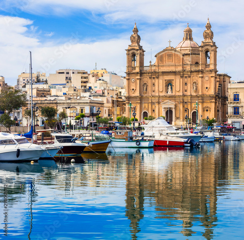 Landmarks of Malta - Msida cathedral and marina with the sail boats
