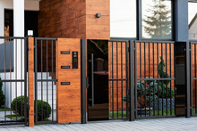 Modern House Exterior With Safety Gate.