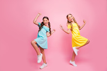 Full Body Profile Photo Of Two People Funny Small School Ladies Models Rejoicing Summer Holidays Start Wear Bright Blue Yellow Dresses Isolated Pink Color Background
