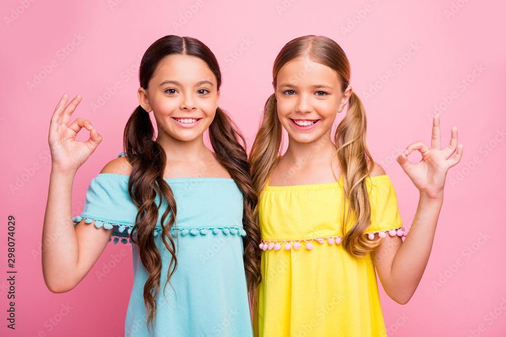 Fototapety, obrazy: Photo of two beautiful small school ladies classmates lovely street look showing okey symbol expressing agreement wear blue yellow dresses isolated pink color background