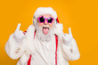 canvas print picture Close up photo of crazy funny hipster santa claus show horns sign tongue-out want rock-and-roll concert instead x-mas tradition celebration wear hat trendy suspenders isolated yellow color background