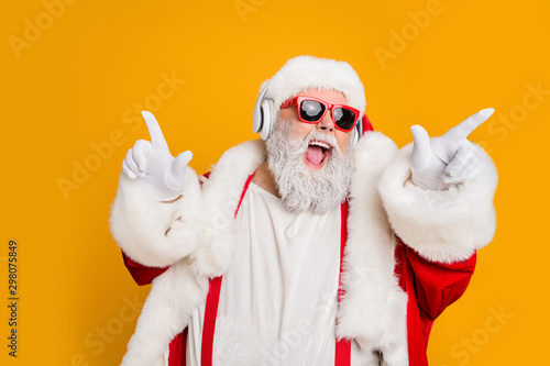 Nightclub invite on christmas party celebration funky crazy santa claus dj in white headset sing song sound melody listen music dance wear stylish x-mas hat suspenders isolated yellow color background - 298075849