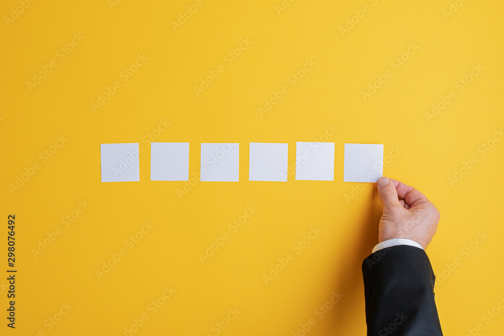 Fototapety, obrazy: Placing six blank post it papers in a row