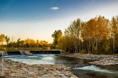 Leinwand Poster Boise River and Rocks at Sunset