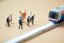 Miniature People Waiting Train At Early Morning Rush Hours. Thai Public Transportation Concept