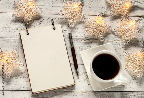 cup of coffee and book on wooden background - 298087474