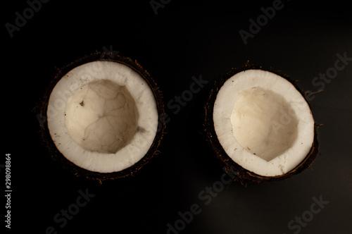 Valokuva ugly organic coconut on a black background, isolate