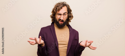 Fotomural  young bearded crazy man feeling clueless and confused, not sure which choice or