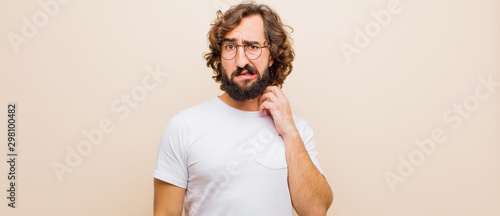Fotografia young bearded crazy man feeling stressed, frustrated and tired, rubbing painful