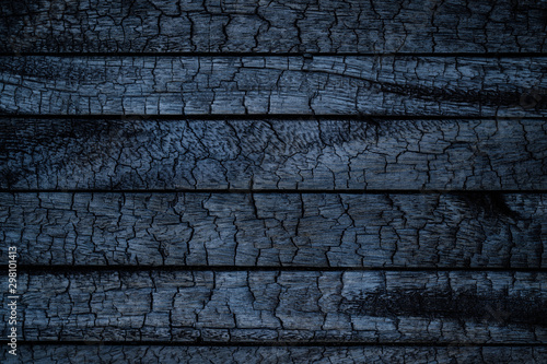 Poster Firewood texture BBQ background. Burnt wooden Board texture. Burned scratched hardwood surface. Smoking wood plank background. Burned wooden grunge texture