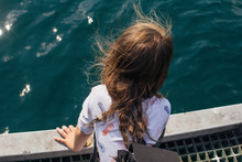 Young Girl Leaning Over Jetty