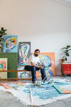 Artist Painting In His Studio