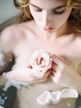 Delicate Young Girl With Flower In Bathtub