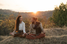Couple Doing Yoga In Nature
