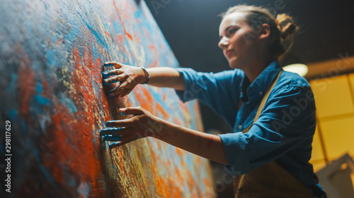 Fototapeta Talented Innovative Female Artist Draws with Her Hands on the Large Canvas, Using Fingers She Creates Colorful, Emotional, Sensual Oil Painting. Contemporary Painter Creating Abstract Modern Art obraz