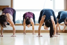 Yoga Group Practicing Crow Pose Together.