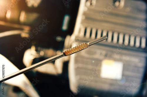 Fotografía  Automotive oil dipstick to check engine oil level