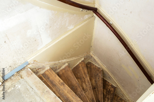 Old dirty damaged abandoned wooden stairs needs renovation,