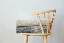 Folded Blankets On Wood Chair