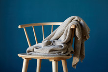 Seat And Blanket With Blue Wall Background